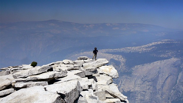 on the peak of Half Dome, climbed up the sheer, nearly vertical ascent to make it to the plateau. Yosemite National Park