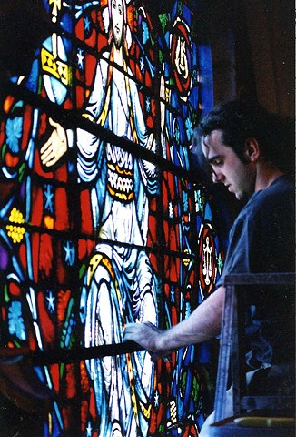 restoring the gothic rose window at Boston University's Marsh Chapel, while an apprentice glassman at the studio of Burnham & Laroche, MA.(photo by Kevin Ryan)