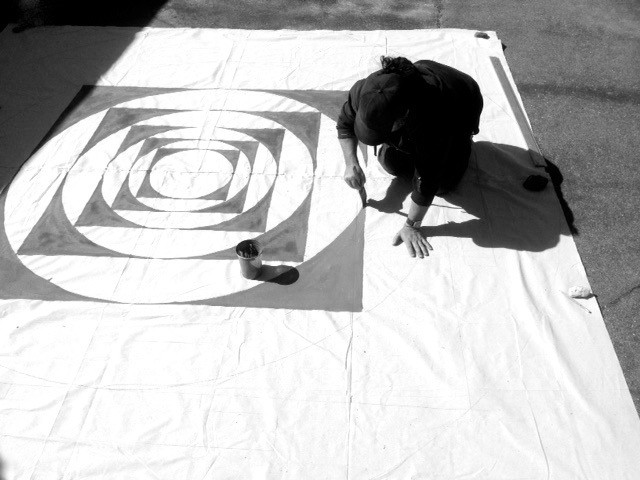 painting a mandala floor painting for Esalen Workshops