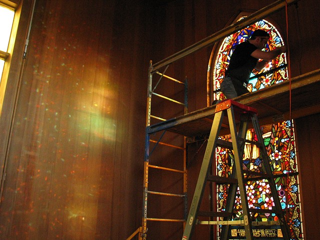 installing restored window for Saint John's Presbyterian church, San Francisco CA