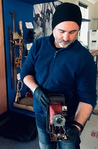holding novelist Jack London's camera. London made thousands of negatives with this camera all over the world. Lead mount-maker for the exhibit renewal at Jack London Museum, Glen Ellen CA  (w/ Gizmo Inc.)