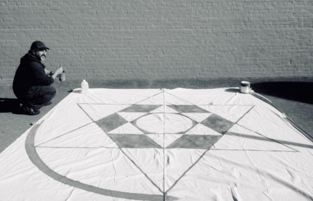 painting a floor painting of the Star of David for Esalen Workshops