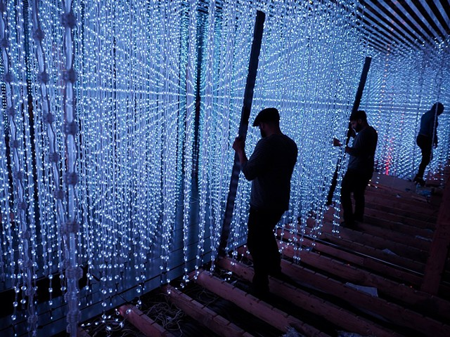 exhibit installer on the exhibit 'Crystal Universe' by Tokyo-based art collective TEAMLAB,  Pace Art + Technology, Palo Alto CA (c/o Gizmo Inc) (photo by Po Bym)