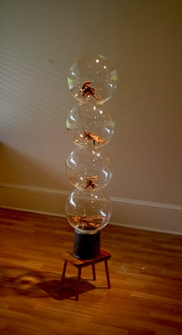 wood sculpture with paint and acrylic spheres