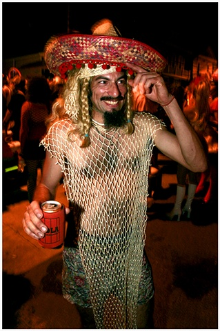 "6- Jorge Lopez poses for a portrait in his ""meshican"" costume at Mid-Summer Mardi Gras."