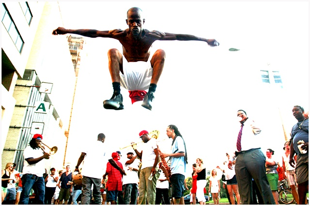 "Darryl Young A.K.A. ""Dancing Man""  Jumps or as he calls it ""pogos""  during the Katrina second line and memorial unveiling."
