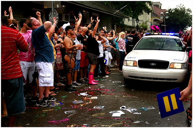 The police escort for the southern decadence parade tries to disperse people so that the parade can travel down St. Ann, and reach their final leg of their journey down Bourbon Street. Tropical Storm Lee caused the cancellation of numerous events for Labo