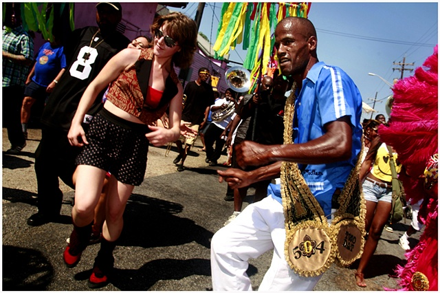 Elsie Semmes and Darryl Young dance down Rampart Street during a second line celebrating and honoring the grand opening of The New Orleans Healing Center. The second line traveled down Rampart to the New Orleans Healing Center with their arrival kicking o