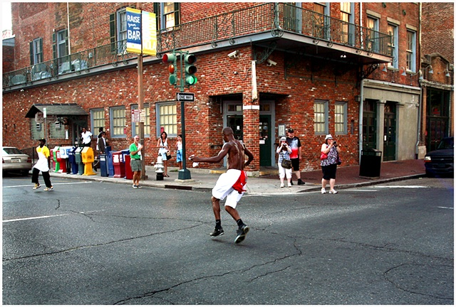 "Darryl Young A.K.A. ""Dancing Man"" dances in the street during the Katrina second line and memorial unveiling."