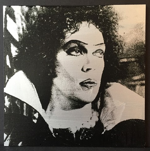 screenprinted image of tim curry's frank 'n' furter on silver-painted board. edition of 3.