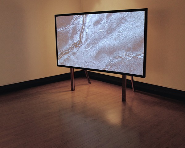 Projected video of Michael Heizer City and Great Basin by Michael Boonstra.