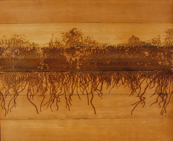 a drawing referencing forest fires by Michael Boonstra using laser engraved wood and acrylic