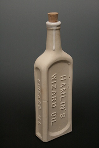 snake oil, wizard oil, cure all, ceramic flask