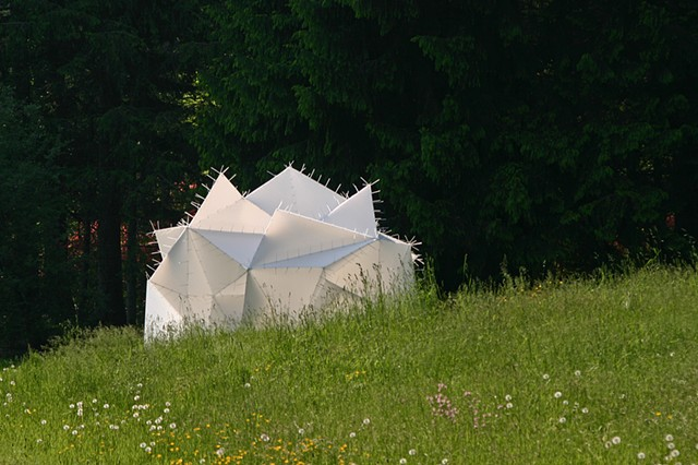 Sanctum - A translucent light retreat constructed of corrugated plastic and cable ties