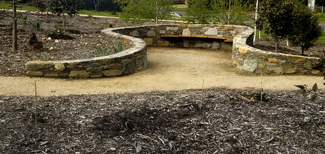 castlemaine victoria artisan stone wall and wood hand carved bench seat curved