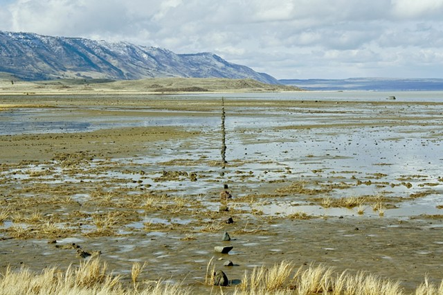 True North. 1500 foot line of stones set in the mud flat of Summer Lake, Or., orientated to the north star.  2012. Archival ink jet print, 20x13