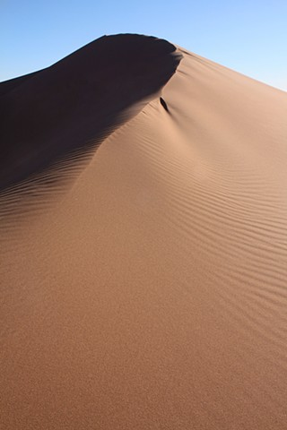 The Peak of a Dune in the Sahara Desert