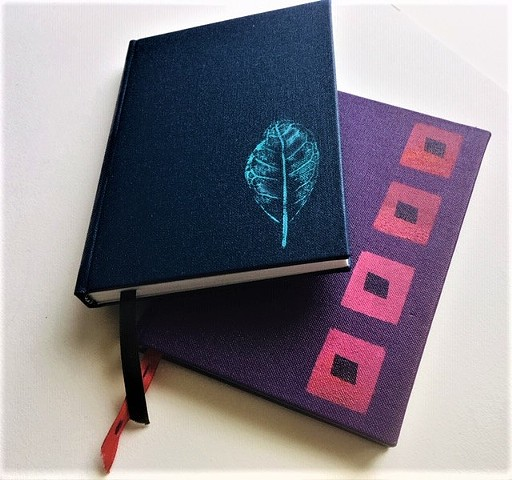 Small case bound books with stencilled covers