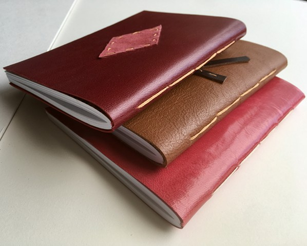 Leather pamphlet stitch notebooks