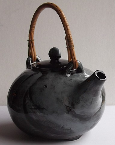 874. wicker handle teapot