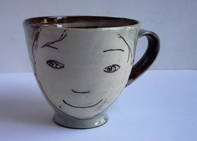 cup with faces