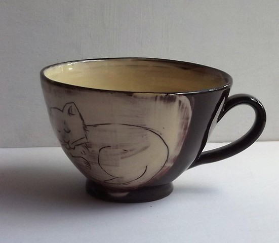 Tea cup with cat and dog