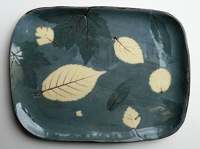 blue plate with leaves