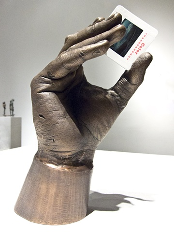 A digital photograph by Columbus Ohio artist and OCAC alumni Stephen Takacs of a bronze hand statue holding a Kodachrome slide