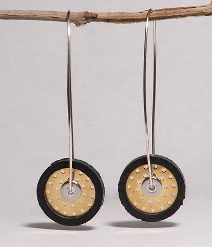 Sculptural mixed-material earrings.