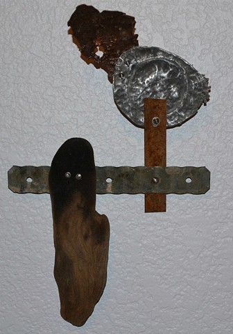 contemporary found-object mixed media wall sculpture