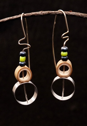 Sculptural mixed-material earrings with movement!