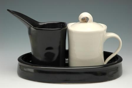 Black creamer, white sugar : set with tray