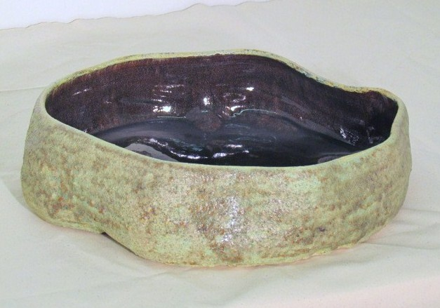 Large shallow vessel with crater glaze
