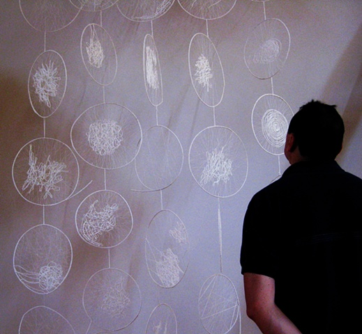 At the vernissage my husband admiring one of Ewas works.