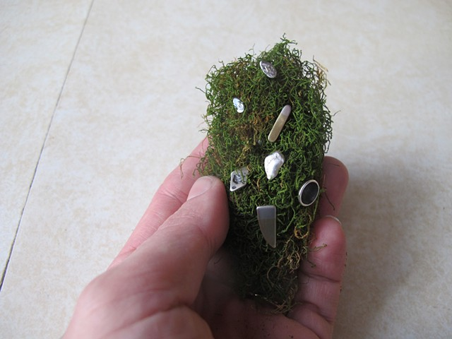 moss clump with miscellaneous studs, in hand