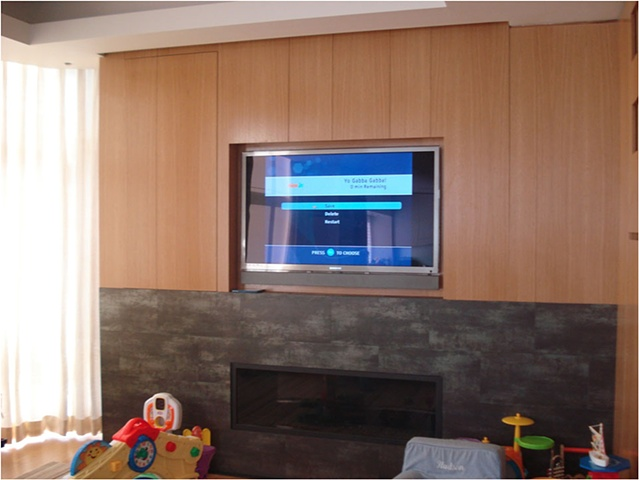 Quarter Sawn White Oak Entertainment Center and Fireplace Surround.