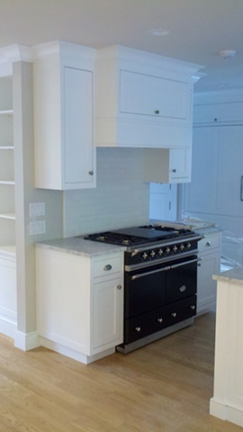 Hood and cabinetry in  Kitchen built using FSC certified material for LEED project.