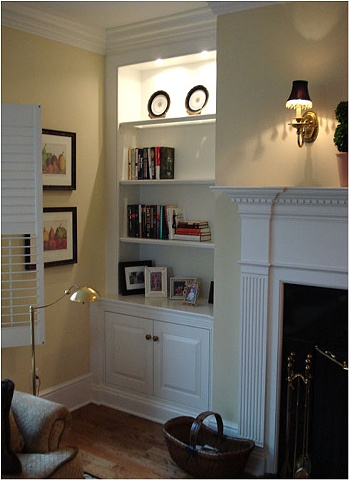 Corner cabinet and mantel.