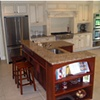 Island and Cabinetry in white classical style kitchen.