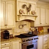 Cabinetry and Hood in French country style Kitchen.