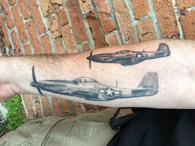 a pair of p-51 mustangs... big one is healed