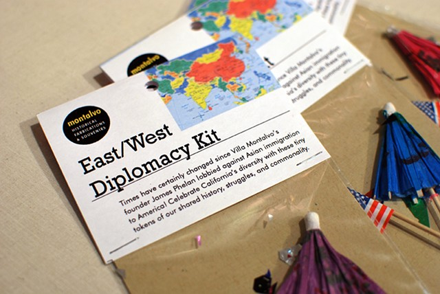 East/West Diplomacy Kit 2012 A composition of flag-toothpick, cocktail umbrella, and confetti