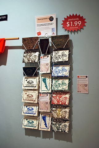 Hand-printed Postcard Display  2012 Carved linoleum blocks, prints, and packaging
