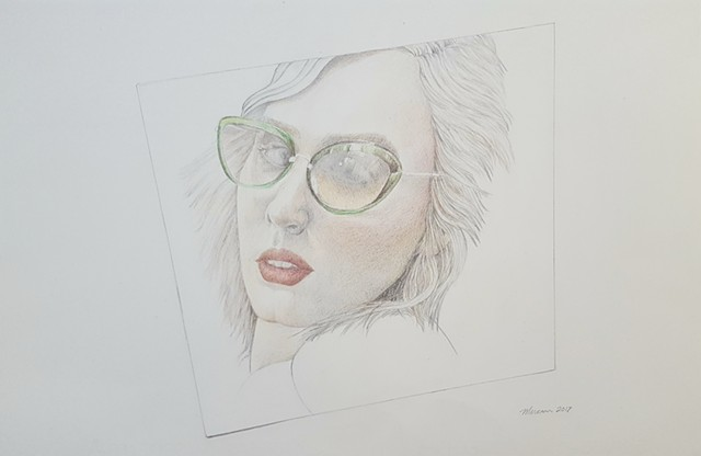 realistic colored pencil drawing of woman in green glasses by artist Lori Markman