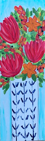 bright flowers in patterned vase by tracy yarbrough