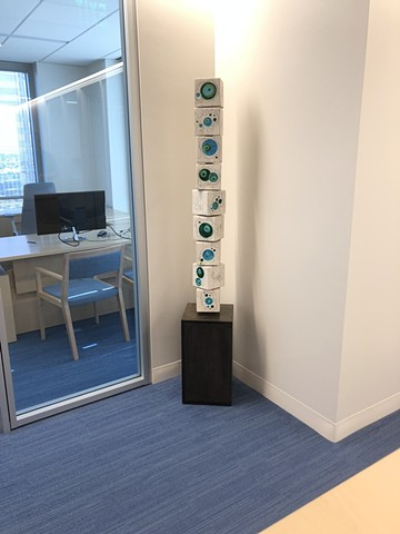 Blue green totem in an office