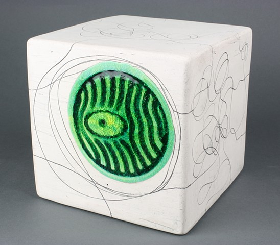 Handmade white earthenware cube with fused glass and rusted iron