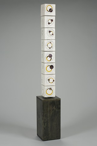 Interactive Totem Made of clay, wood, steel, glass