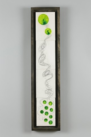 Wall art made with white earthenware, glass, iron wash, wood