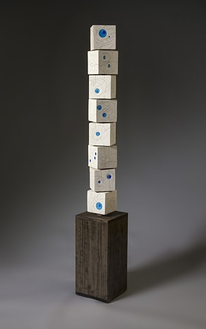 """Endless Line Totem"" with blue glass and blocks askew"
